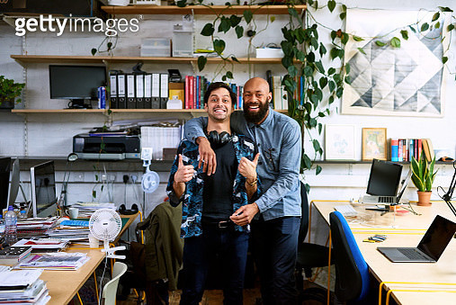 Friendly mid adult colleagues smiling at camera - gettyimageskorea