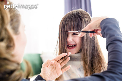 Young girl getting haircut - gettyimageskorea