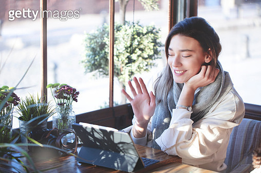 Beautiful young woman using a phone and making a video call - gettyimageskorea