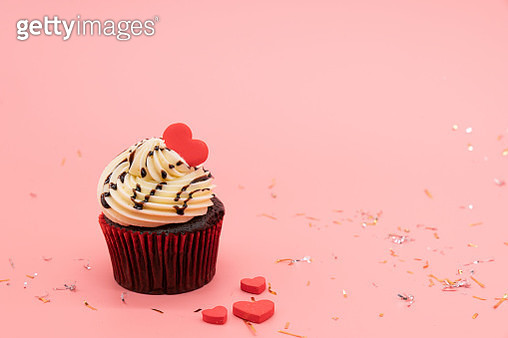 Cupcake decorated with a heart shaped cake pick - gettyimageskorea