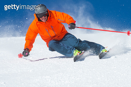 A man skiing on a sunny winter day - gettyimageskorea