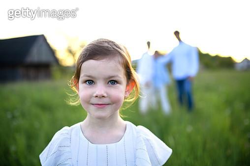 Portrait of cute child on a walk in countryside. - gettyimageskorea