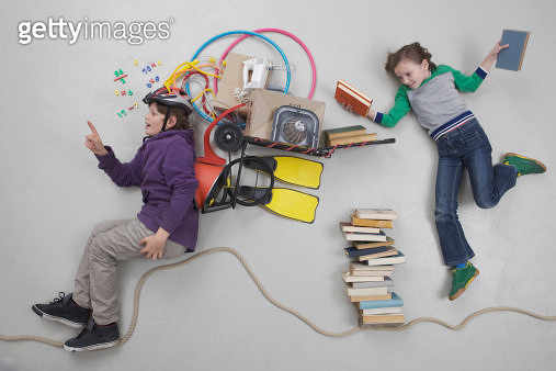 Boy calculating while girl holding books - gettyimageskorea