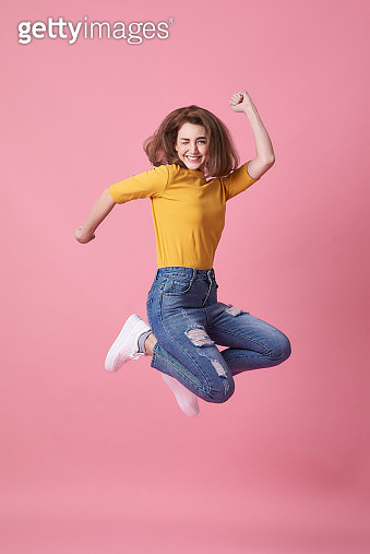 Portrait Of Happy Young Woman Jumping Against Pink Background - gettyimageskorea