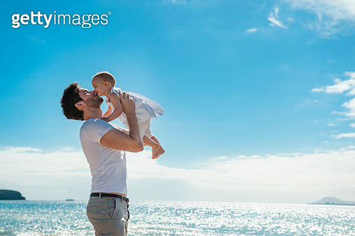 Spain, Lanzarote, father cuddling his little daughter on the beach - gettyimageskorea