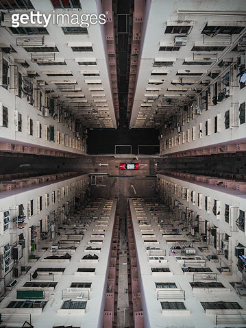 Taxi parked at the bottom of a building atrium, Hong Kong - gettyimageskorea