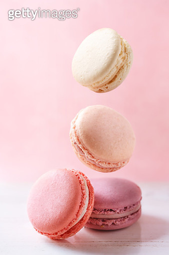 Close-Up Of Macaroons On Table Against White Background - gettyimageskorea
