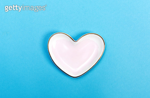 Heart shaped candy dish on blue - gettyimageskorea