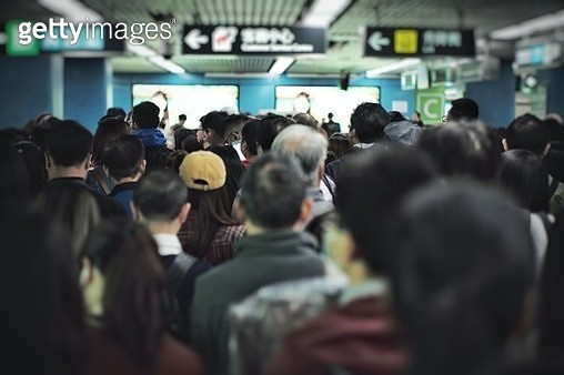 Rear View Crowd Of People In Entrance Of Subway Station - gettyimageskorea