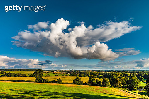 Big white cloud over the colorful valley, sunset time, Brittany, France - gettyimageskorea
