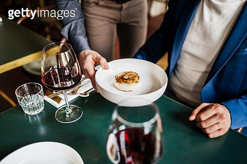 Waiter Serving Customer Starter Dish In Restaurant - gettyimageskorea