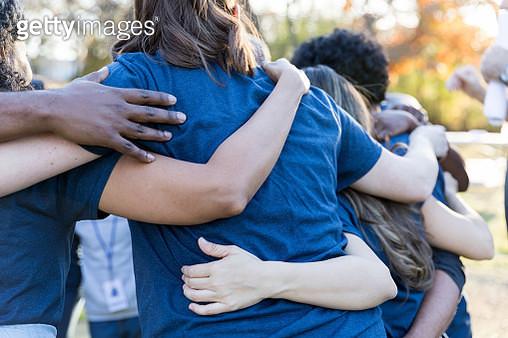 Volunteers bonding during charity event - gettyimageskorea