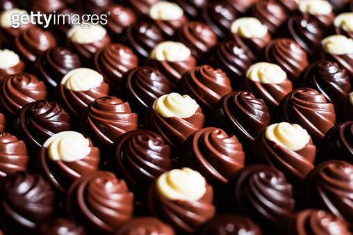 Premium collection of dark, milk and white chocolate sweets, selective focus. Chocolate background. Macro food photography. Collection of candies. - gettyimageskorea