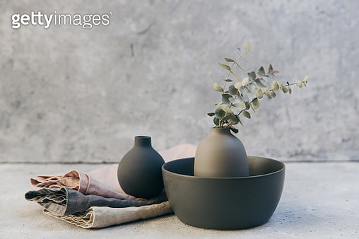 Home decor - neutral coloured vases and dish-ware and linen napkin in nordic style against grey wall. - gettyimageskorea