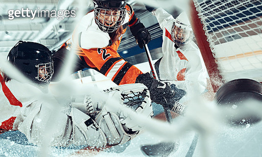 The ice hockey sport female players in action, motion, movement. Sport comptetition concpet, girls on training or game at arena - gettyimageskorea