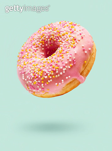 Close-Up Of Donut Against Blue Background - gettyimageskorea
