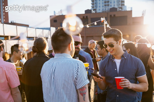Crowd enjoying urban rooftop party - gettyimageskorea