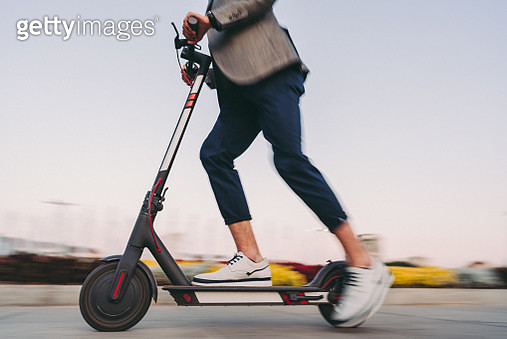 Businessman riding a motor scooter in Sofia - gettyimageskorea