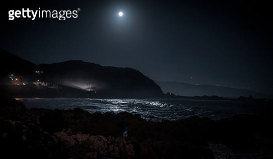 Scenic View Of Sea Against Sky At Night - gettyimageskorea