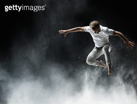 young man in air with white powder - gettyimageskorea