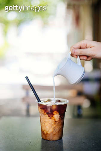 Pouring cream in cold brew coffee - gettyimageskorea