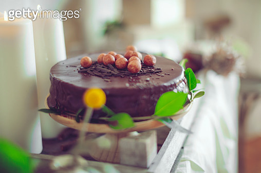 Table setting with flowers and chocolate cake - gettyimageskorea