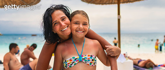 Portrait of Mother and daughter smiling on the beach - gettyimageskorea