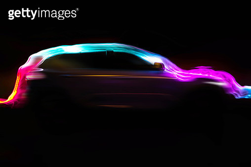 Modern car with aerodynamic colorful light trail at night. - gettyimageskorea