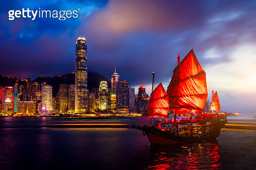 Hong Kong City skyline with tourist sailboat at night. View from across Victoria Harbor Hong Kong. - gettyimageskorea