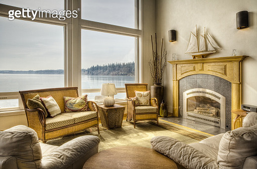 Luxury living room overlooking lake - gettyimageskorea