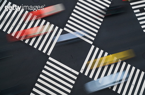 Tokyo. Multi colored taxis crossing zebra lines at Ginza. - gettyimageskorea