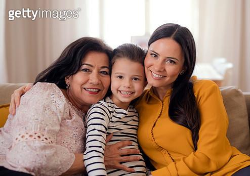 Portrait of three generations of women indoors. - gettyimageskorea