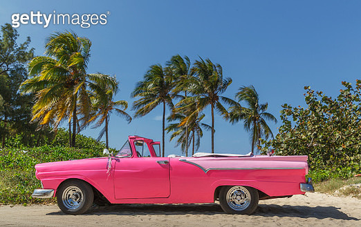 Pink vintage car on a cuban beach. - gettyimageskorea