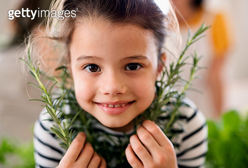 Small child indoors playing. - gettyimageskorea