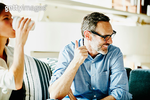 Laughing businessman in meeting with colleagues - gettyimageskorea