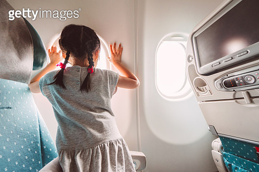 Little girl anticipating aeroplane to take off - gettyimageskorea
