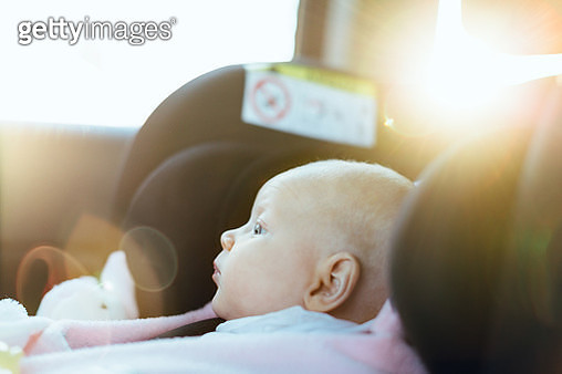 Young baby in car seat in car, close-up - gettyimageskorea