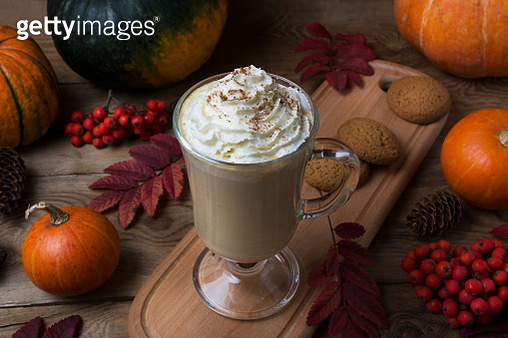Pumpkin spice coffee latte with whipped cream and cookies - gettyimageskorea