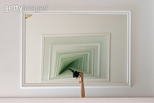 Cropped Arm Holding Camera In Between Two Mirrors - gettyimageskorea