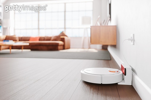 Robot Vacuum Cleaner In A Modern Living Room - gettyimageskorea