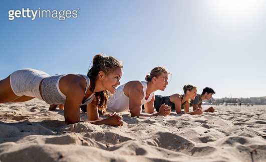 Athletic women training at the beach - gettyimageskorea