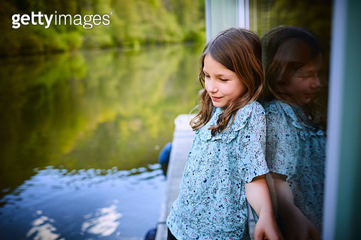 Girl standing on a houseboat - gettyimageskorea