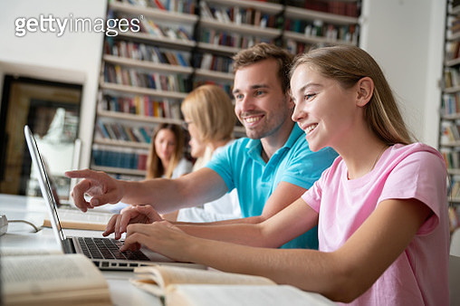 Students researching online at a library - gettyimageskorea