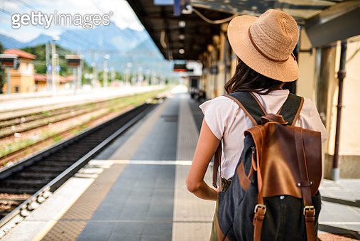 Photo of a female traveler waiting the train - gettyimageskorea