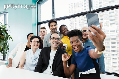 Business people taking selfie in modern office - gettyimageskorea