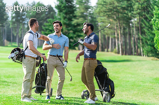 Friends Playing Golf on a Beautiful Sunny Day - gettyimageskorea