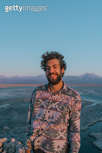 Young Caucasian man on the background of scenic view of lake in Atacama desert - gettyimageskorea