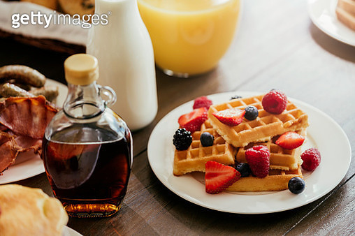 Delicious Breakfast with Cereals, Waffles, Croissants and Fresh Fruits - gettyimageskorea