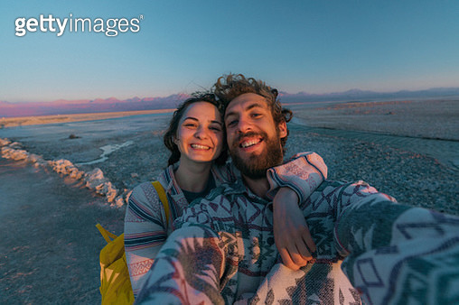 Selfie of young Caucasian woman and man near the  lake in Atacama desert, CHile - gettyimageskorea