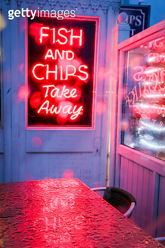 Neon fish and chips sign - gettyimageskorea